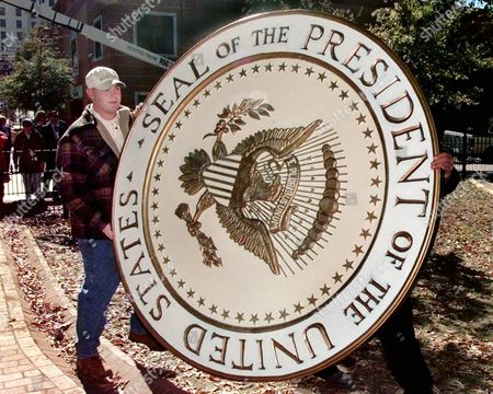 WARD Thomas Ward of Little Rock, Ark., working for a local contractor, carries an oversized Seal of the President of the United States, which will be placed on the stage at the Old State House in Little Rock for President Clinton's election night rally on Tuesday