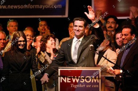 NEWSOM San Francisco supervisor Gavin Newsom, center, with wife Kimberly Guilfoyle Newsom, left, waves to supporters at his campaign party at the Regency Building in San Francisco on . Newsom finished first in the general mayoral election and will face a runoff against a Green Party candidate, Board of Supervisors President Matt Gonzalez