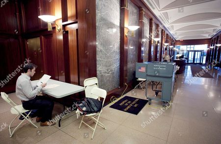 Stock Photo of Brendan Reilly Brendan Reilly completes an election affidavit prior to casting his ballot at a polling station in the lobby of his apartment building on Wall Street in New York, . Voters in New York, Connecticut, Delaware, Rhode Island and Pennsylvania are voting in the Republican presidential primaries Tuesday. Reilly, who voted for Ron Paul, is hoping for a brokered Republican convention to block Mitt Romney's nomination