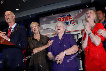 Rick Scott, Ann Scott, Esther Scott, Allison Guimard Florida Governor elect Rick Scott, left, speaks as his wife Ann, second from left, mother Esther Scott, and daughter Allison Guimard laugh, in Fort Lauderdale, Fla
