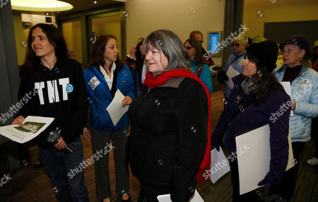 Karen Dike, Xiuhtezcatl Martinez Xiuhtezcatl Martinez, left, of Earth Guardians, joins Karen Dike of Our Longmont, and other anti-fracking activists in waiting to enter the meeting of members of the Oil and Gas Task Force as it puts the final touches on recommendations for Colorado Gov. John Hickenlooper to consider in the settlement of disputes over oil and gas drilling, in Denver. The meeting comes as some activists have renewed a campaign to banning the use of hydraulic fracturing in the state. Activists handed over studies to show the potential harm in the use of fracking to explore for natural gas and oil