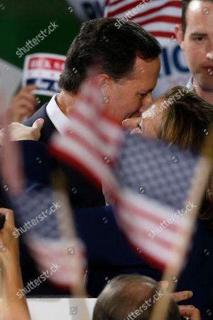 Rick Santorum, Karen Santorum Former U.S. Sen. Rick Santorum, left, embraces his wife Karen after he announced his candidacy for the Republican nomination in the 2016 presidential race on in Cabot, Pa