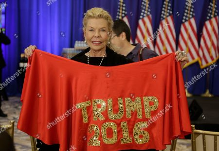 Lois Pope Lois Pope, a supporter of Republican presidential candidate Donald Trump, poses with her shawl before a news conference at the Trump National Golf Club, in Jupiter, Fla