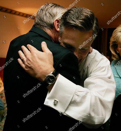 HUNTSMAN Republican Jon Huntsman Jr, right, is hugged by his father, Jon Huntsman Sr. after winning the governorship, Tuesday night, in Salt Lake City
