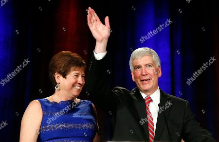 Rick Snyder Gov. Rick Snyder, with his wife Sue, waves to supporters at a election night party in Detroit . Snyder won a second term Tuesday, defeating Democrat Mark Schauer after a race in which the Republican touted an economic and fiscal turnaround and promised to keep Michigan on the right path