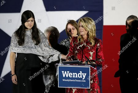 Wendy Davis, Election Dru Davis, left, daughter of Texas Democratic gubernatorial candidate Wendy Davis, consoles her mother as Davis becomes emotional while making her concession speech at her election watch party, in Fort Worth, Texas. Davis mother, Ginger Russell, left rear, sister Jennifer James and brother Joey Russell, right, watch during the speech