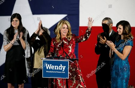 Wendy Davis, Election Texas Democratic gubernatorial candidate Wendy Davis waves to supporters after making her concession speech at her election watch party, in Fort Worth, Texas. Davis' family, daughter Dru, from left, mother Ginger Russell, brother Joey Russell and daughter Amber, right, watch during the speech