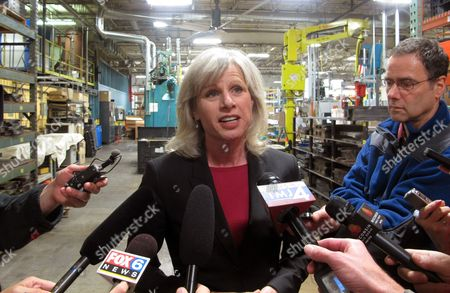 """Democratic gubernatorial candidate Mary Burke calls accusations that she was fired from her family business Trek Bicycles """"complete lies"""" at a campaign stop, in Port Washington, Wis. Burke blames Gov. Scott Walker's political allies for spreading the story just days before the election as an attempt to smear her credibility"""