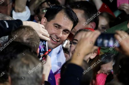 Scott Walker Wisconsin Republican Gov. Scott Walker takes a picture with a supporter after speaking at his campaign party, in West Allis, Wis. Walker defeated Democratic gubernatorial challenger Mary Burke