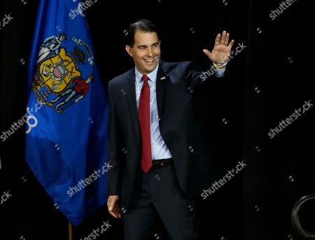 Stock Image of Scott Walker Wisconsin Republican Gov. Scott Walker waves as he is introduced at his campaign party, in West Allis, Wis. Walker defeated Democratic gubernatorial challenger Mary Burke