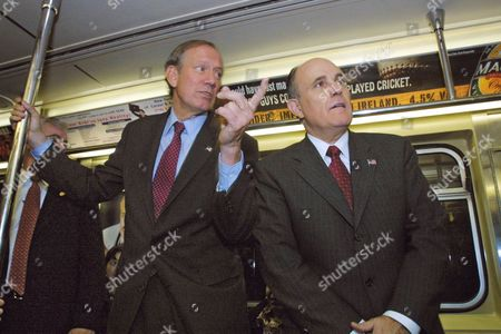 PATAKI GIULIANI New York Gov. George Pataki, left, and former New York City Mayor Rudolph Giuliani ride the 7 Train on their way to a campaign event in the Queens borough of New York, . Republican incumbent Pataki is enjoying a comfortable lead over the Democratic Party challenger H. Carl McCall as the election enters its final stretch