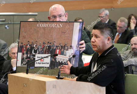 Stock Photo of Richard Valle, Alan Scott Kings County Board of Supervisor Richard Valle, right, points to a photo held by Alan Scott, showing citizens of the town of Corcoran who object to the construction of the proposed high-speed rail system, during a hearing of the high speed rail board in Sacramento, Calif., . Valle said that the people shown in the photo object to the rail project because many would lose their homes due to its construction