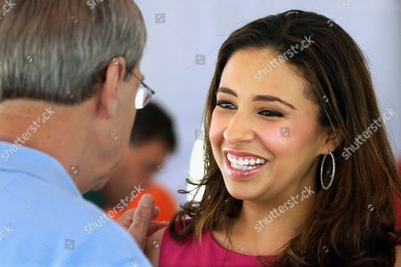 """Erika Harold In this July 25, 2013 photo, former Miss America Erika Harold speaks with Republican supporters at a fund-raising event in Springfield, Ill. Harold, a Taylorville Republican who is running for Congress in Illinois' 13th District, says Illinois Republicans are using """"political obstructionism"""" to stymie her bid to unseat incumbent Rep. Rodney Davis. In a statement, Erika Harold says """"elections are not coronations"""