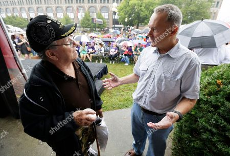 Michael Fitzgerald Iowa Treasurer Michael Fitzgerald, right, talks with Jerry McCullough, of Bondurant, Iowa, left, during the opening day of the Iowa State Fair, in Des Moines, Iowa. Some television stations are refusing to run a new publicly-funded ad for a popular college program that features Fitzgerald, which critics say was timed to boost his image before the November election