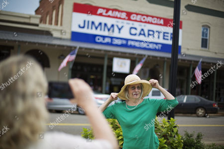 Paula McNeill By Melinda Groover, of Birmingham, Ala., as they visit the hometown of former President Jimmy Carter in Plains, Ga., . Carter's 1976 election to the presidency made Plains a tourist destination. The one-block business district specializes in Carter political memorabilia and peanut souvenirs