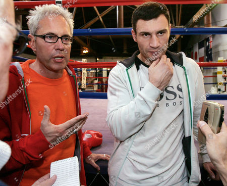 KLITSCHKO BOENTE Vitali Klitschko, right, and his manager Bernd Boente talk with reporters following a light workout and media availability at the La Brea Academy boxing gym in Los Angeles . Klitschko is preparing to meet Danny Williams for the heavyweight championship in a fight in Las Vegas on Dec. 11. He and his brother Wladimir have also been outspoken in their protest of the disputed presidential election in Ukraine, their homeland