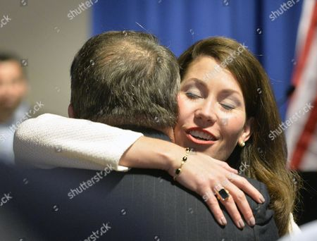 Alison Lundergan Grimes, Jerry Lundergan Kentucky Secretary of State Alison Lundergan Grimes, right, embraces her father, Jerry Lundergan, as she arrives to announce her candidacy for re-election in Lexington, Ky