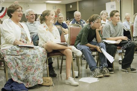 Stock Image of Carol Cook Ventura De Anza Middle school teacher Carol Cook, left, and her students listen to homeless city council candidate Brian Lee Rencher?s speech, in Ventura, Calif. Rencher is one of the 10 candidates vying for four open council seats in the Nov. 4 election. It?s the 37-year-old?s third try for a seat in the coastal community of 100,000. The students, from left to right; Alexandra Eubanks, 13, Justin Baker, 14 and Kevin Denharder, 13, will have to pick their favorite candidate after hearing the speeches for a student council project