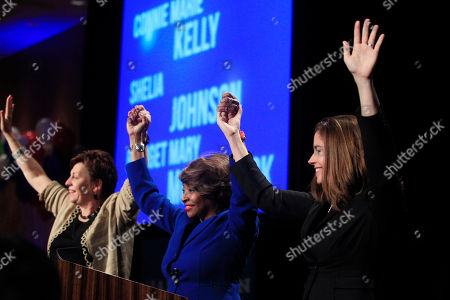 Connie Marie Kelley, Sheila Johnson, Bridget Marie McCormack Michigan Democratic Supreme Court candidates from left, Connie Marie Kelley, Sheila Johnson and Bridget Marie McCormack holds hands as they are introduced during the Michigan Democratic election night party at the MGM Grand Detroit