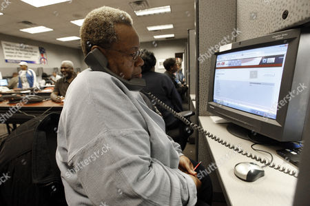 Stock Photo of United Auto Workers retiree Betty Thomas calls potential voters from a phone bank on Election Day at the UAW Region 1 technical training center in Warren, Mich