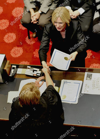 Lorie Skjerven Gildea Hands her election certificate to Chief Justice Lorie Skjerven Gildea in the Minnesota Senate chambers as the 2011 Legislature convened in St. Paul, Minn. Fischbach was elected president of the senate