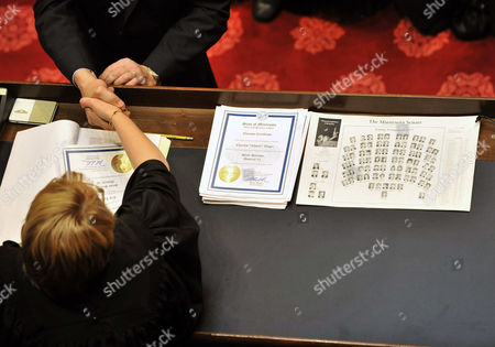 Lorie Skjerven Gildea A senator hands the election certificate to Chief Justice Lorie Skjerven Gildea in the Minnesota Senate chambers as the 2011 Legislature convened in St. Paul, Minn. Fischbach was elected president of the senate