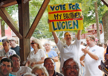 Carie Smith Sisterly pride shows as Carie Smith waves a homemade sign supporting her brother Lucien Smith, a Republican candidate for state treasurer during his speech at the Neshoba County Fair in Philadelphia, Miss
