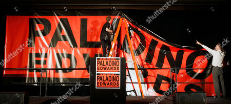 Carl Paladino Workers install a banner for Republican gubernatorial candidate Carl Paladino at his election night headquarters in Buffalo, N.Y