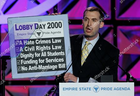 Stock Image of Ross Levi Empire State Pride Agenda Executive Director Ross Levi shows a list of the items on the groups' 2000 agenda that have been achieved while speaking at the Empire State Pride Agenda's fall dinner in New York