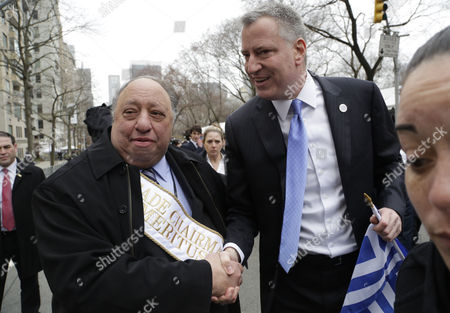 Bill de Blasio, John Catsimatidis Grocery store magnate John Catsimatidis, left, greets New York Mayor Bill de Blasio as he marched up Fifth Avenue in the Greek Independence Day Parade, in New York. Catsimatidis was defeated in the Republican mayoral primary in 2013 by Joe Lhota, who then lost to de Blasio in the general election