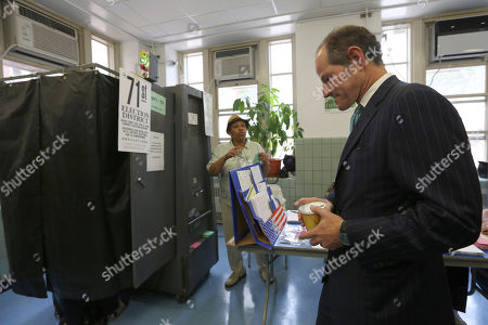 Eliot Spitzer Democratic comptroller hopeful Eliot Spitzer waits his turn to cast his vote in the primary election at his polling station in New York