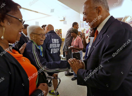 Bill Thompson New York City Democratic mayoral hopeful Bill Thompson, right, greets 91-year-old Virgina Fields, center, as he campaigns at the Central Harlem Senior Citizens Center, in New York