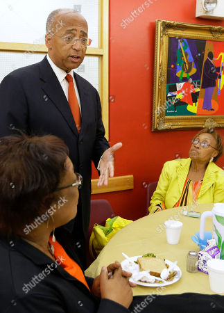 Bill Thompson Carrie Taylor, 72, right, listens to New York City Democratic mayoral hopeful Bill Thompson, as he campaigns at the Central Harlem Senior Citizens Center, in New York