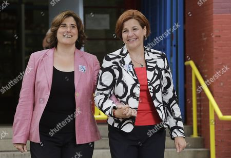Stock Picture of Christine Quinn, Kim Catullo City Council Speaker and New York City Democratic mayoral hopeful Christine Quinn, right, walks out of a polling station with her wife, Kim Catullo, after voting in the primary election in New York, . Quinn led the polls for most of the year but has seen support disappear as her rivals linked her to the bitter debate to let Bloomberg run for a third term in 2009