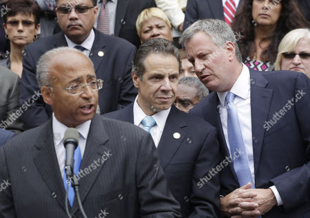 Bill De Blasio Bill Thompson Andrew Cuomo Democratic mayoral candidate Bill Thompson, left, gives a concession speech to his primary election opponent Bill de Blasio, right, as New York Governor Andrew Cuomo center, listens on the steps of City Hall, in New York. Thompson's concession to de Blasio, avoids a runoff election in the Democratic primary, leaving de Blasio to face Republican candidate Joe Lhota in the Nov. 5 election