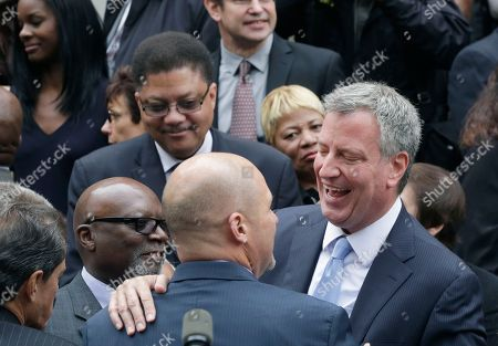Bill De Blasio Bill Thompson Andrew Cuomo Democratic mayoral candidate Bill de Blasio, right, embraces a supporter on the steps of City Hall, in New York. His primary opponent, Bill Thompson, earlier conceded to de Blasio, avoiding a runoff election in the Democratic primary, leaving de Blasio to face Republican candidate Joe Lhota in the Nov. 5 election