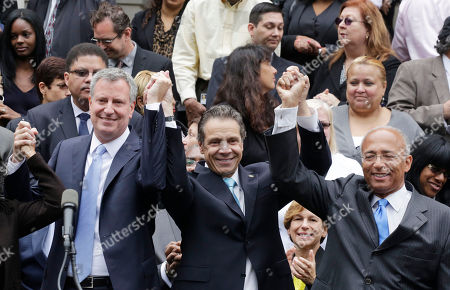 Bill De Blasio Bill Thompson Andrew Cuomo New York Governor Andrew Cuomo, center, raises the hands of Democratic mayoral candidates Bill de Blasio, left, and Bill Thompson on the steps of City Hall, in New York. Thompson conceded to de Blasio, avoiding a runoff election in the Democratic primary, leaving de Blasio to face Republican candidate Joe Lhota in the Nov. 5 election