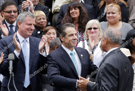 Stock Image of Bill De Blasio Bill Thompson Andrew Cuomo New York Governor Andrew Cuomo, center, greets Democratic mayoral candidates Bill Thompson, right, after Thompson conceded the primary election to Bill de Blasio, left, on the steps of City Hall, in New York. Thompson's concession to de Blasio, avoids a runoff election in the Democratic primary, leaving de Blasio to face Republican candidate Joe Lhota in the Nov. 5 election