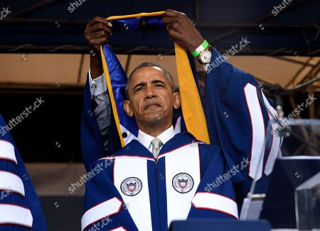 """Barack Obama, Vernon Jordan President Barack Obama is awarded an honorary Doctor of Science degree from Howard University in Washington, by Vernon Jordan. Obama said Saturday that the country is """"a better place today"""" than when he graduated from college more than 30 years ago, citing his historic election as """"one indicator of how attitudes have changed."""" But gaps persist, he told Howard University's Class of 2016, citing racism and inequality"""
