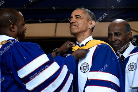 """Barack Obama, Vernon Jordan, Wayne A.I. Frederick Howard University President Wayne A.I. Frederick, left, adjusts the sash of President Barack Obama, center, as he is awarded an honorary Doctor of Science degree from Howard University in Washington, by Vernon Jordan, right. Obama says the country is """"a better place today"""" than when he graduated from college more than 30 years ago, citing his historic election as """"one indicator of how attitudes have changed"""