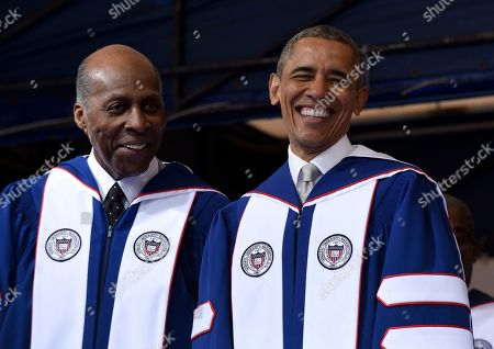 Barack Obama, Vernon Jordan President Barack Obama, right, shares a laugh with Vernon Jordan, left, as they attend the commencement ceremony for the 2016 graduating class of Howard University in Washington