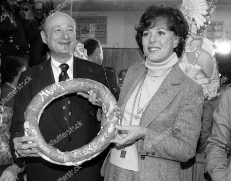 New York Mayor Edward Koch, left, holds a bagel commemorating his election victory during a visit to a New York bakery with former Miss America Bess Myerson. Myerson, the first Jewish Miss America who parlayed her stunning 1945 victory into national celebrity, died Dec. 14, 2014, at her home in Santa Monica, Calif. She was 90. She landed a series of television jobs before her appointment as New York City's chief consumer watchdog in 1969. Myerson helped Koch win the 1977 mayoral race