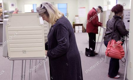 Stock Image of Jenny Edwards Jenny Edwards, left, votes at the Hamilton County Board of Elections, in Cincinnati on the first day of early voting for the Nov. 8 election. Ohio is one of 32 states that allow any voter to cast an early ballot by mail or in person without a reason