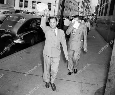 """Stock Image of Michael Coppola, Trigger Mike Coppola, David Lehmann Michael """"Trigger Mike"""" Coppola, (left front), and his father-in-law, David T. Lehmann, (rear right), 63, arrive at Criminal Court Building, New York City, . Coppola, Lehmann, and Coppola's lawyer were taken before a grand jury on July 30, to explain the source of $15,000 cash deposited in the city prison within an hour after Lehmann had been held in that amount of bail as a material witness in connection with the 1946 Election Day fatal beating of Joseph Scottoriggio"""