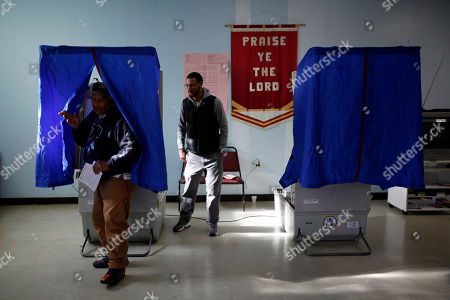 Voter Robert L Johnson steps out of the booth after casting his ballot in Pennsylvania primary election at Memorial Gospel Crusades Church, in Philadelphia