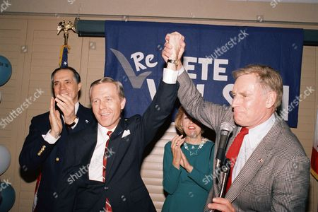 Pete Wilson Actor Charlton Heston holds up the arm of Sen. Pete Wilson, R-Calif., during appearance before supporters at the Century Plaza Hotel in Los Angeles on . Lt. Gov. Leo McCarthy is challenging Wilson fro the Senate Seat. Left is John Gavin, former ambassador to Mexico