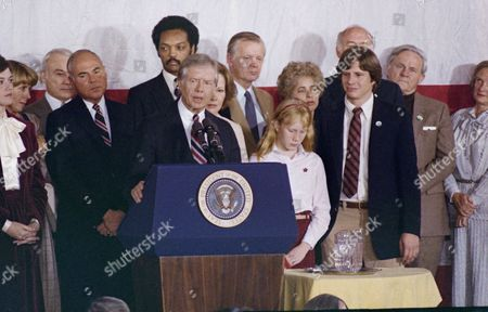 Stock Picture of U.S. President Jimmy Carter concedes defeat in the presidential election as he addresses a group of Carter-Mondale supporters in Washington, D.C., . Standing behind Carter is his wife, Rosalynn, and at right is their daughter Amy. In the background behind the first family, from left, are Rev. Jesse Jackson, Agricultural Sec. Bob Bergland and Health and Human Service Sec. Patricia Harris
