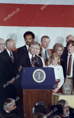 U.S. President Jimmy Carter concedes defeat in the presidential election as he addresses a group of Carter-Mondale supporters in Washington, D.C., . Standing behind Carter is his wife, Rosalynn, and at right is their daughter Amy. In the background behind the first family, from left, are Rev. Jesse Jackson, Agricultural Sec. Bob Bergland and Health and Human Service Sec. Patricia Harris