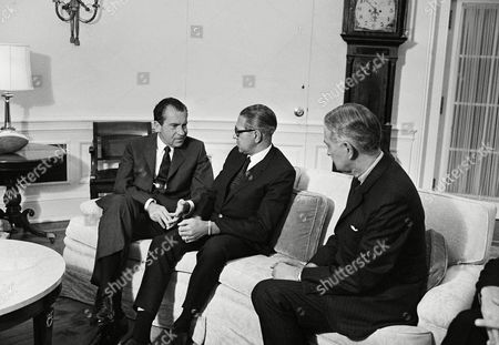 U.S. President Richard Nixon talks with John E. Thomas, right, newly elected director of the intergovernmental committee for European Migration (ICEM) in the White House prior to Thomas' departure for Geneva, Switzerland to assume his duties as head of the 31-nation-sponsored organization, in Washington. ICEM has handles the resettlement of more than 1 ½ million European refugees in new homelands since World War II. Thomas was chief of the U.S. Refugee program in Vietnam Before his election to the ICEM post