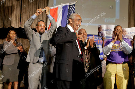 Rep. Charlie Rangel, D-NY, center, arrives to speak at his primary election night gathering, in New York. Rangel is seeking his 23rd term against opponent state Sen. Adriano Espaillat